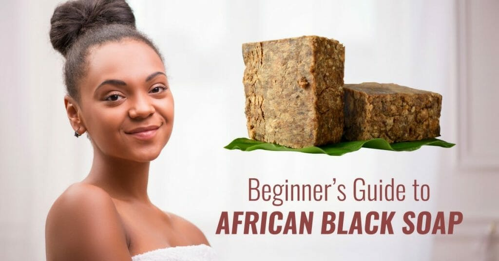 black woman with african black soap (1)