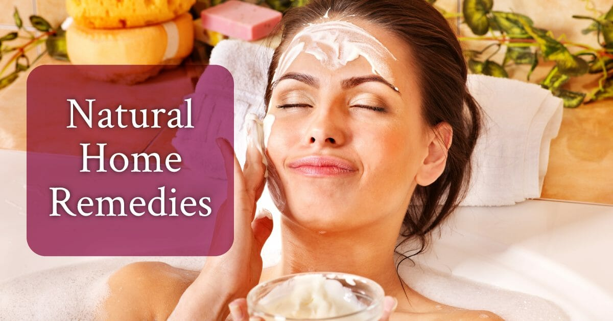 woman putting homemade cream on face