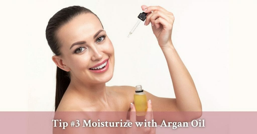 middle aged woman applying argan oil