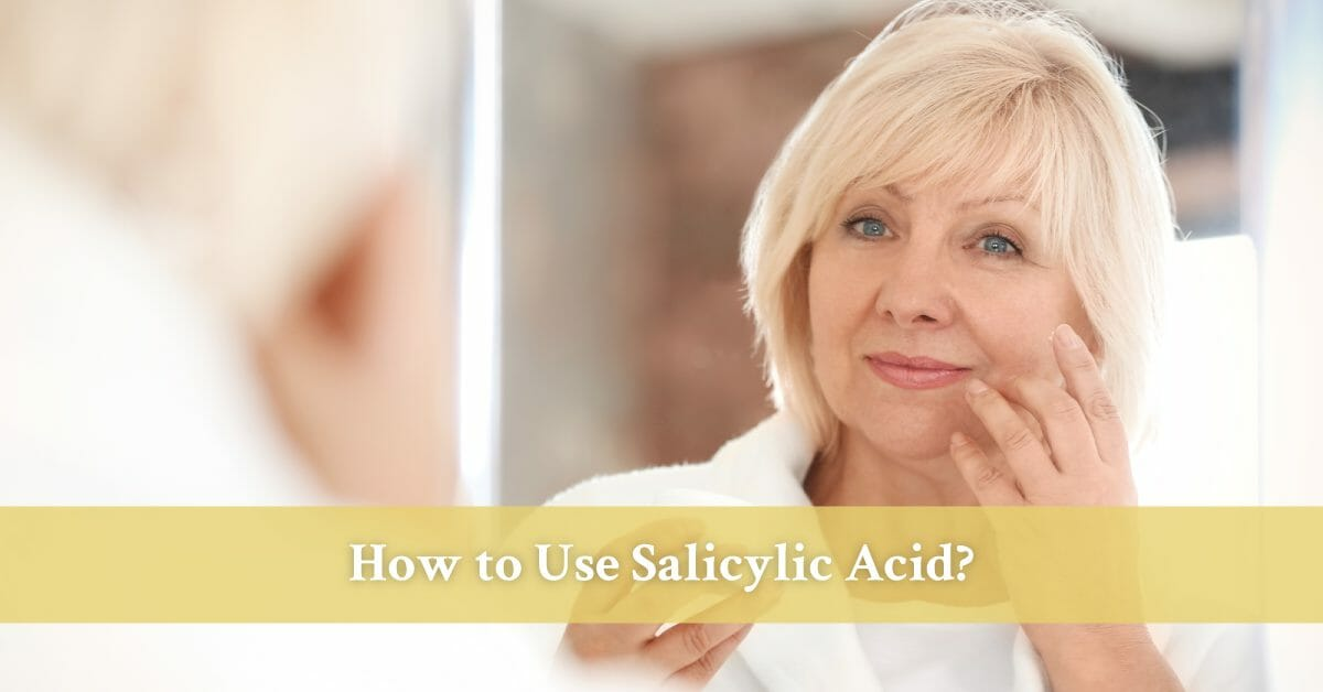 mature woman applying salicylic acid cream