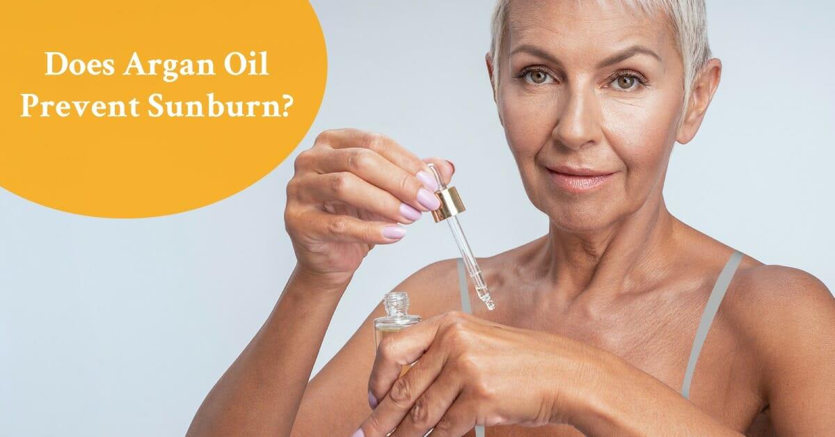 mature woman holding argan oil